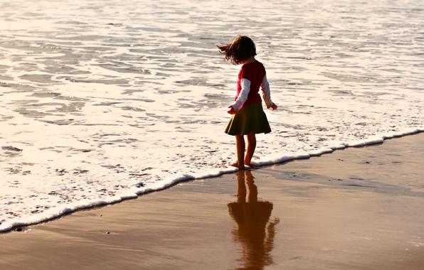 ребенок у моря/4348076_507236 (596x380, 182Kb)