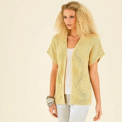 Вязание спицами модных безрукавок для женщин 81