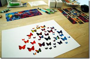 Чтобы картинка была объёмная, бабочек не сильно сложите пополам и приклеивайте их на различном возвышении.