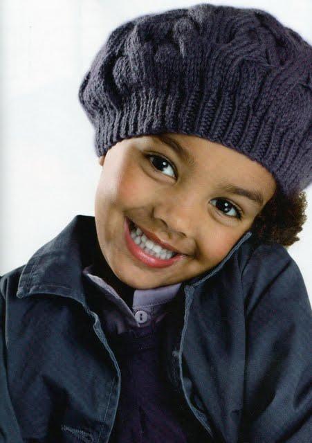 Описание: Детский берет вязаная спицами Сапку.
