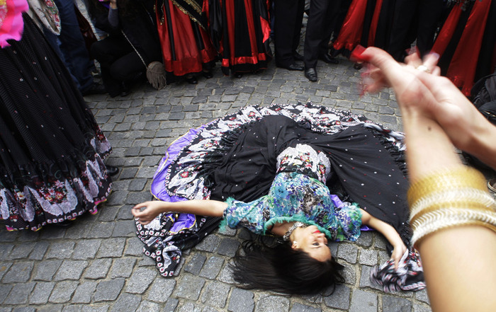 Dancers of the World Roma festival Khamoro dance at the Old Town square in Prague, Czech Republic, Thursday, May 28, 2009. (AP Photo/Petr David Josek)