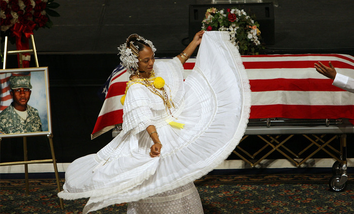 Chamara Tomlinson performs a traditional Praise Dance in front of the casket of Spc. Roberto A. Hernandez II, 21, of Far Rockaway, New York, during his funeral June 12, 2009 in the Brooklyn borough of New York City. Spc. Hernandez was killed of wounds sustained when his mounted patrol was attacked with an improvised explosive device and small arms fire on June 2 in Paktya, Afghanistan. (Spencer Platt/Getty Images)