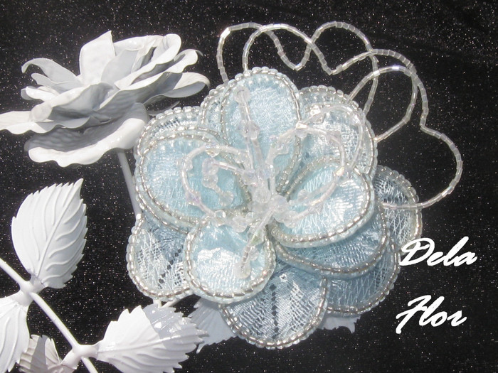flowers made of lace and beads.