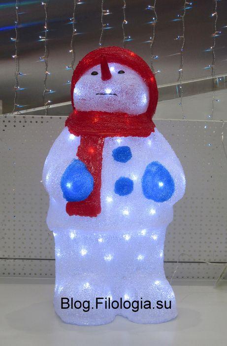 Снеговик в магазине OBI в Москве (461x700, 47Kb)