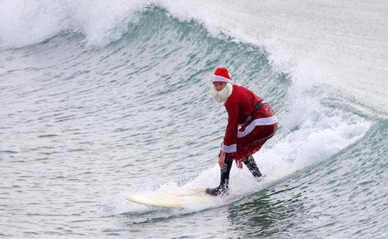 4725cb9b4d705d03_santa-surfing (550x339, 51Kb)