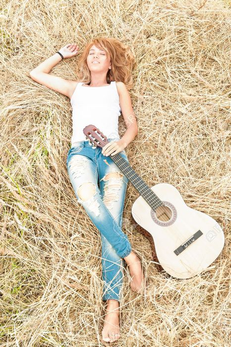 16249854-Beautiful-woman-dreaming-with-closed-eyes-Pretty-girl-lying-in-meadow-with-guitar-Person-holding-mus-Stock-Photo (466x700, 130Kb)