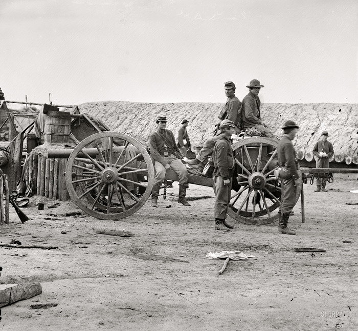 April 1865. Petersburg, Virginia. Federal soldiers removing artillery from Confederate fortifications.