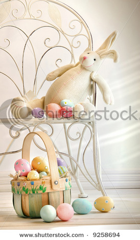 stock-photo-stuffed-rabbit-on-iron-chair-with-easter-basket-and-eggs-9258694 (274x470, 54Kb)
