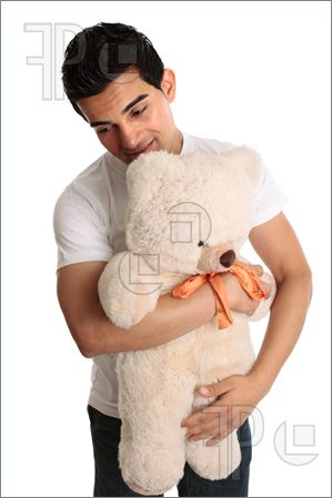 Man-Holding-Toy-Bear-1699759 (299x449, 19Kb)
