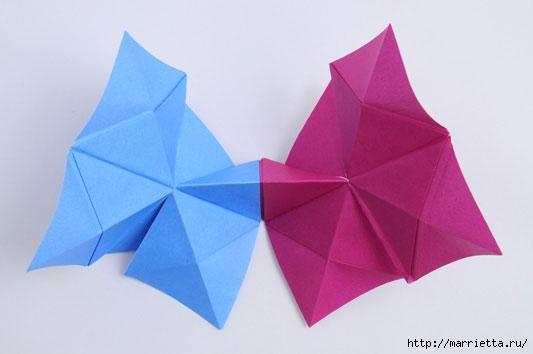 Вы любите складывать оригами.  Очень увлекательное занятие.  Можно сделать вот такую веселенькую люстру.