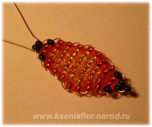 3. Плетение из бисера тельца бабочки Тельце бабочки плетем по следующей схеме: 1-2-2-1-2-2-1-2-1, концы проволоки при.