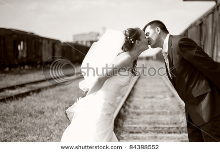 stock-photo-black-and-white-portrait-of-happy-and-beautiful-groom-and-bride-kissing-on-a-railroad-84388552 (450x312, 42Kb)