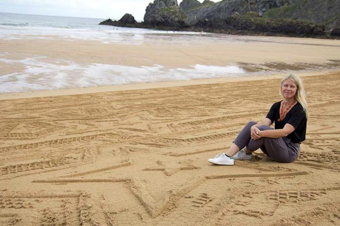 рисунки на песке фото (700x466, 139Kb)