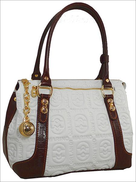 Смотреть все фотографии модных сумок 2012.