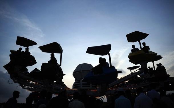 Последний день религиозного праздника Ид аль-Фитр в Карачи, 22 августа 2012 года.
