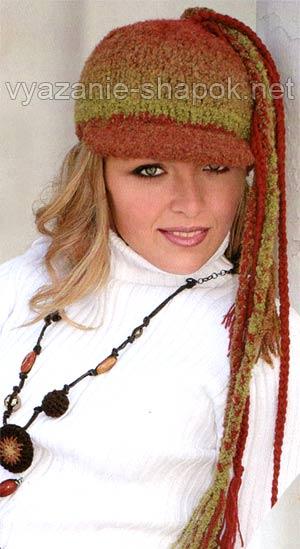 Зимняя вязаная шапка-кепка с хвостиками.