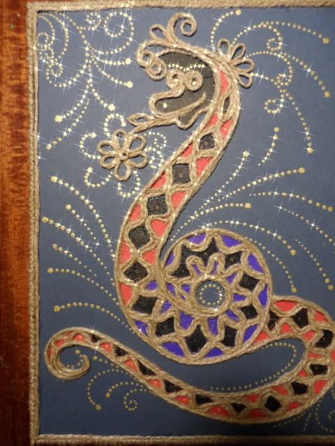 змея талисман