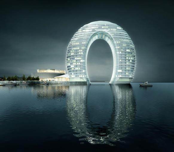 Потрясающей красоты отель Sheraton Huzhou Hot Spring Resort, расположенный в китайском городе Хучжоу. Это уникальное здание представляет собой гигантскую арку высотой 100 метров, подсвеченную тысячами светодиодами (582x509, 29Kb)