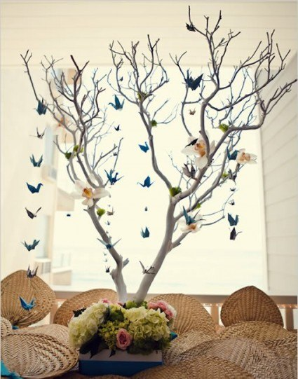 Можно журавликов нацепить на подобное дерево(без листьев)в кадке и поставить на сцену(если разрешат конечно) .