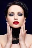 9970923-portrait-of-beautiful-brunette-girl-posing-on-blue-in-black-lacy-collar (115x168, 6Kb)