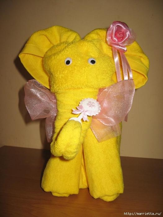 Подарки для новорожденного из памперсов и полотенец (8) (525x700, 242Kb)