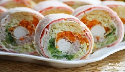 блюда на праздничный стол/5281519_lavash_s_koreiskoi_morkovkoi_i_krabovimi_palochkami226125 (516x300, 94Kb)