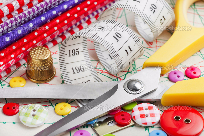 depositphotos_19831539-Sewing-items-buttons-colorful-fabrics-scissors-measuring-tap (700x466, 449Kb)