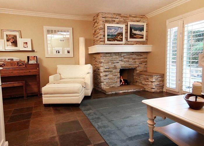 интерьеры гостиных фото с камином