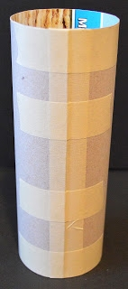 cardboard sleeve pulled off of rolling pin (142x320, 26Kb)