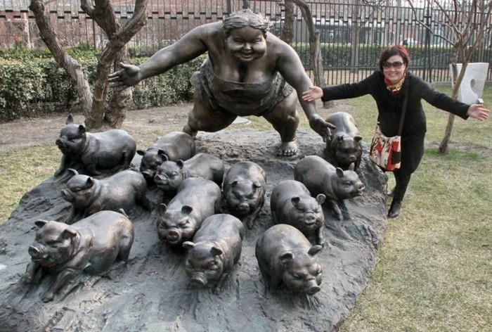 The streets of Beijing are decorated with sculptures of obese women