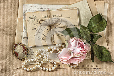 old-letters-postcards-rose-flower-vintage-things-nostalgic-paper-background-dry-47503098 (400x266, 55Kb)