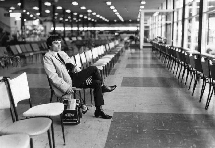 Nicol at the airport alone. No longer a Beatle