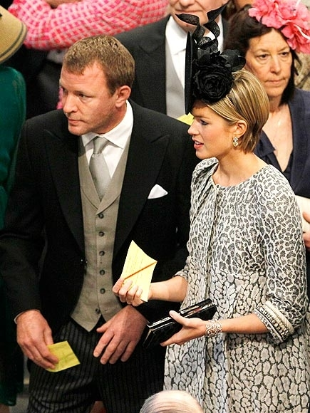 LONDON, ENGLAND - APRIL 29:  British film director Guy Ritchie and his girlfriend Jacqui Ainsley arrive in Westminster Abbey ahead of the Royal Wedding of Prince William to Catherine Middleton at Westminster Abbey on April 29, 2011 in London, England. The