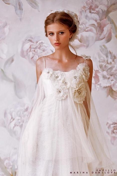 1. Оригинальные свадебные платья этого модного Дома запечатлела в своей...