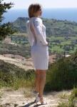 Шерстяное белое вязаное эксклюзивное платье с открытой спиной