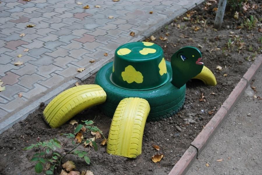 собак поделки из машинных шин для сада фото протяжении всей жизни