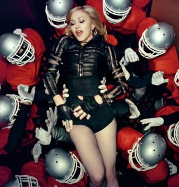 madonna-give-me-all-your-lovin-video12-1328262171-view-0 (358x374, 36Kb)