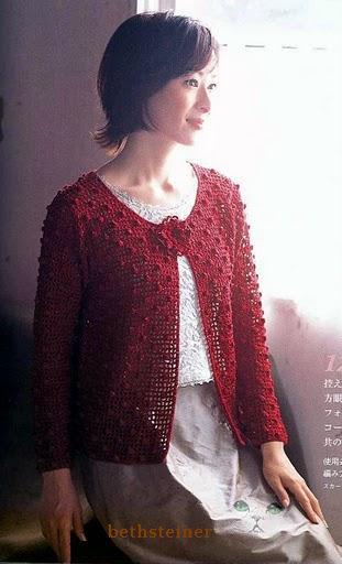 Красная кофта с пупырышками.