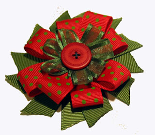 christmas ribbon rosette (320x279, 31Kb)