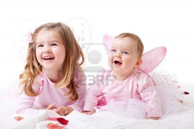 7157267-a-baby-girl-and-her-older-sister-lie-on-the-ground-in-fairy-outfits--horizontal-shot (400x267, 20Kb)