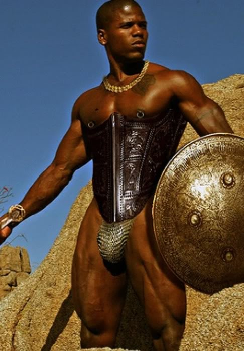 Naked male warrior with shield stock image